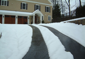 Asphalt driveway with heated tire tracks