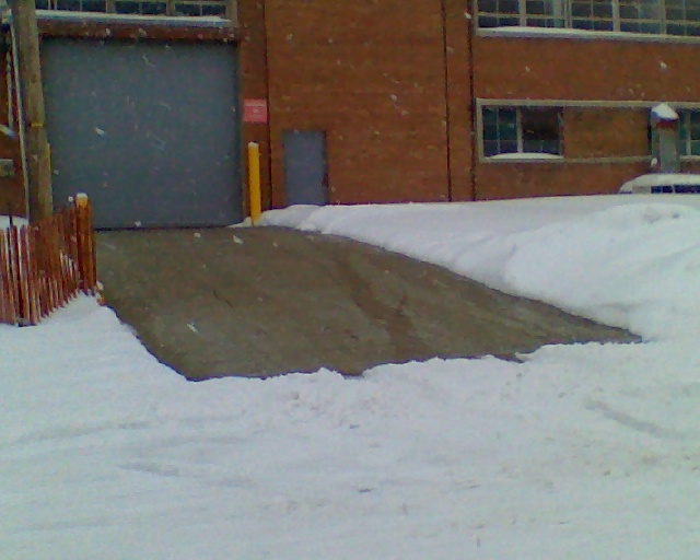 Radiant snow melting system installed in a loading ramp