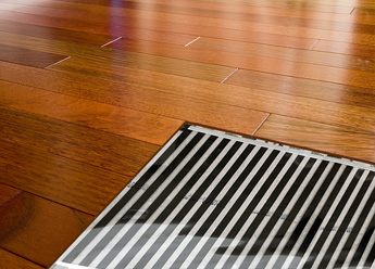Heated hardwood floor with cutaway