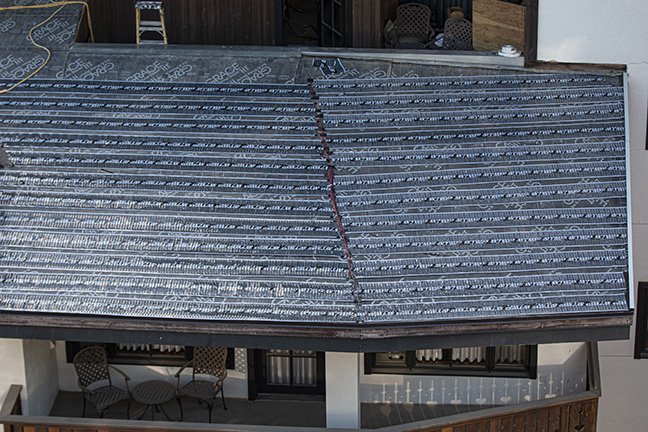 Low-voltage roof heating system being installed