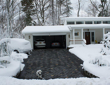 Heated driveway with brick pavers.