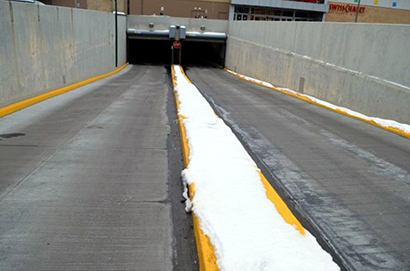 A radiant heated ramp to a commercial parking structure.